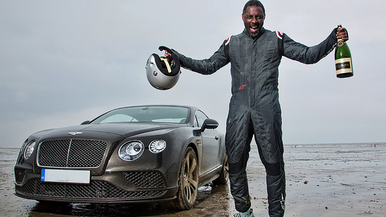 Idris Elba looks like a kid in a candy shop, realizing his childhood dream of racing cars. (Discovery)