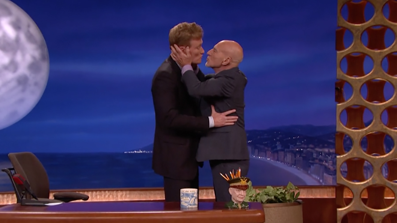 Sir Patrick Stewart goes in for the kiss on Late Night with Conan O'Brien. (TEAMCOCO)
