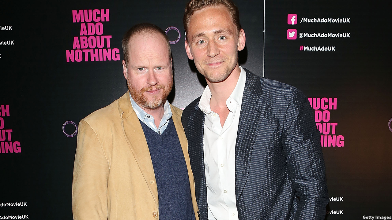 Joss Whedon and Tom Hiddleston take a moment for a snap on the red carpet. (Getty Images)