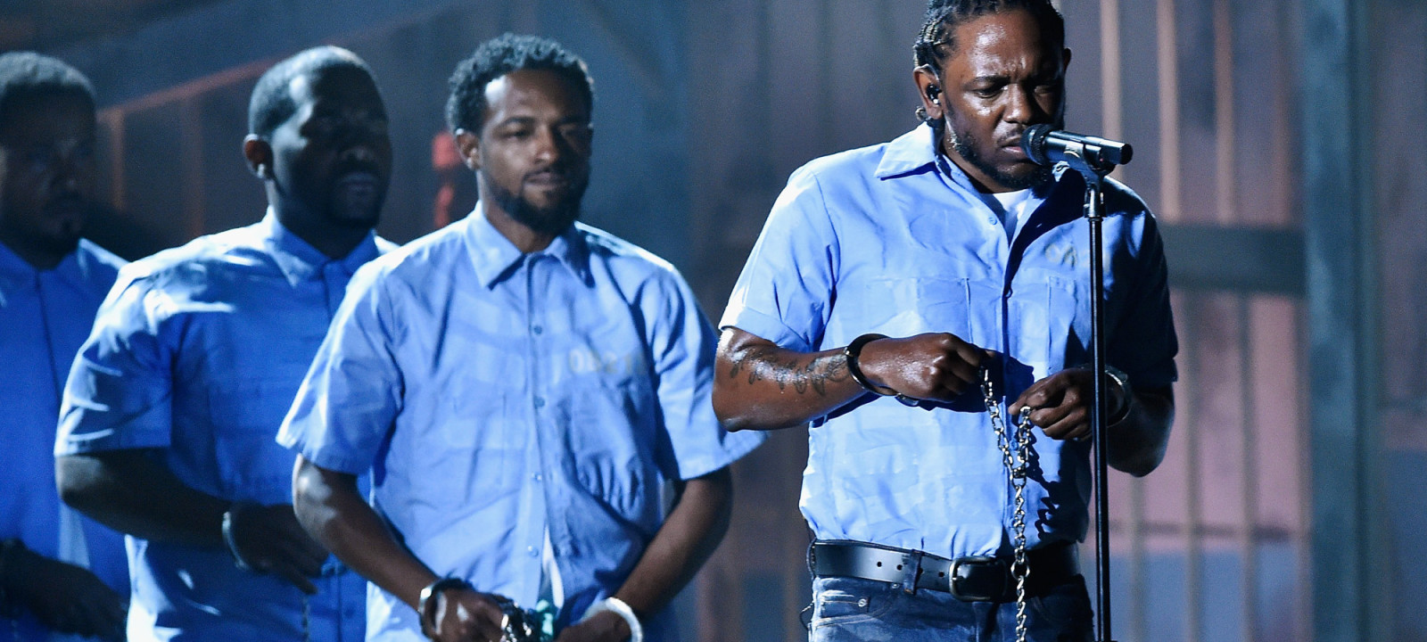 Rapper Kendrick Lamar (C) performs onstage during The 58th GRAMMY Awards at Staples Center on February 15, 2016 in Los Angeles, California.