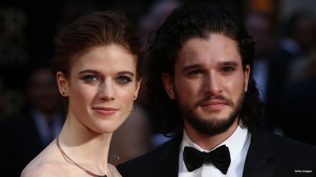 British actor Kit Harington (R) and British actress Rose Leslie (L) pose on the red carpet upon arrival to attend the 2016  Laurence Olivier Awards in London on April 3, 2016.