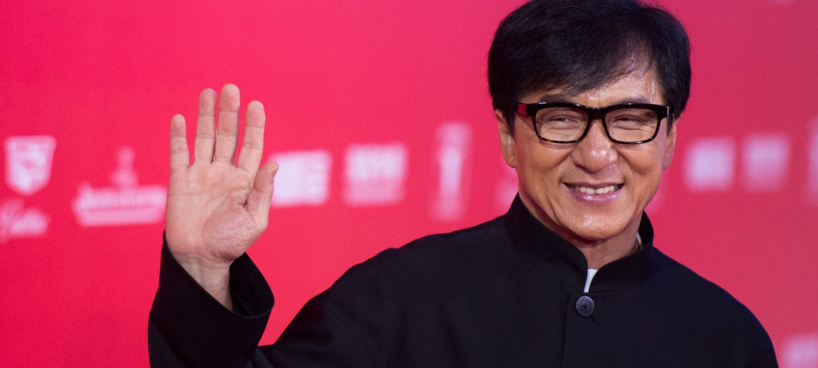 Hong Kong actor Jackie Chan poses on the red carpet during the opening ceremony of the Shanghai International Film Festival (SIFF) in Shanghai on June 13, 2015.  The 18th Shanghai International Film Festival runs from June 13 to 21.