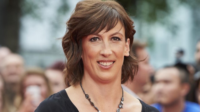 British actress Miranda Hart poses for photographs on the carpet as she arrives to attend the European premiere of the film 'Spy' in London on May 21, 2015.
