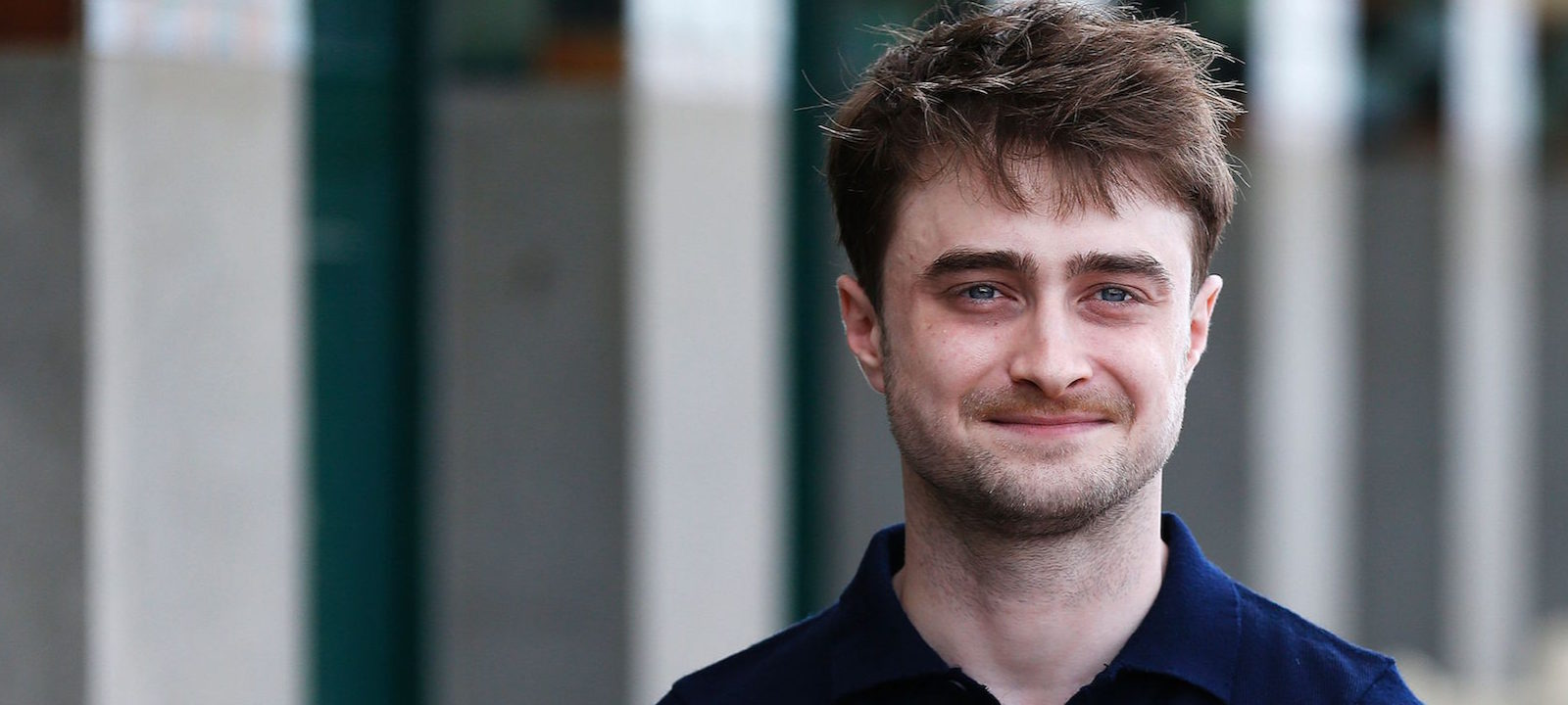British actor Daniel Radcliffe poses for photographs on the Promenade des Planches on September 10, 2016 in the northwestern sea resort of Deauville, as part of the 42nd Deauville US Film Festival.  / AFP / CHARLY TRIBALLEAU