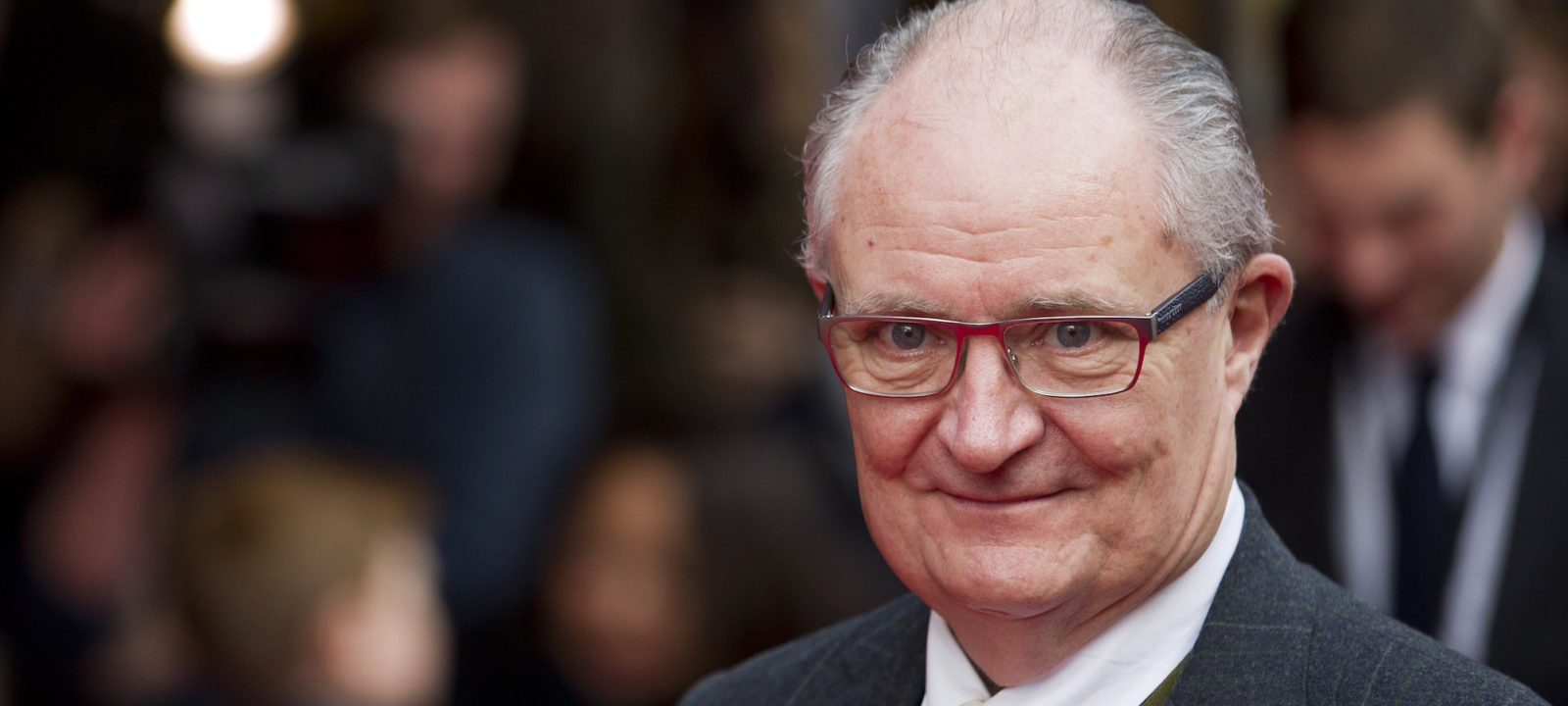 British actor Jim Broadbent poses on the red carpet as he arrives for the World premiere of the film 'Get Santa' in London on November 30, 2014.