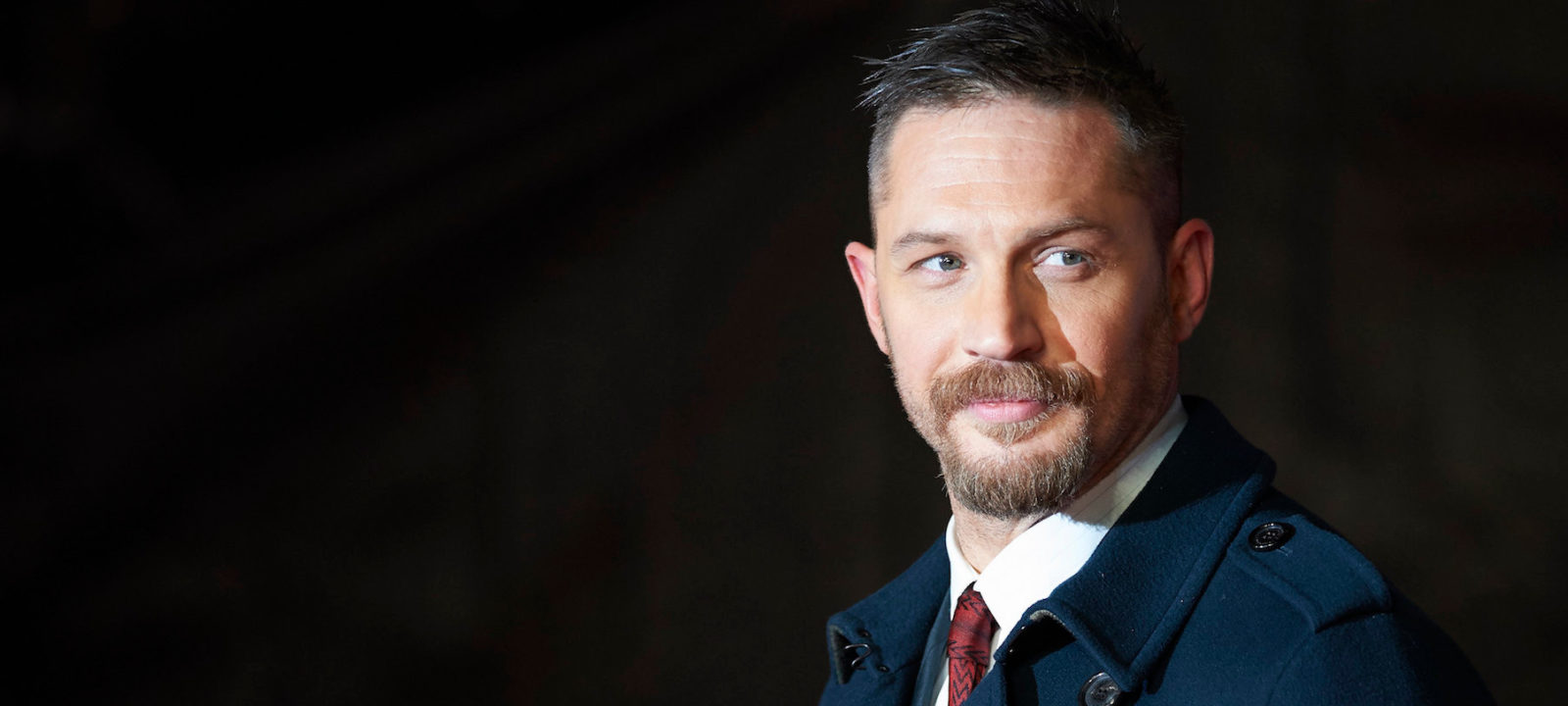 British actor Tom Hardy poses on arrival for the premiere of the film 'The Revenant' in London on January 14, 2016.