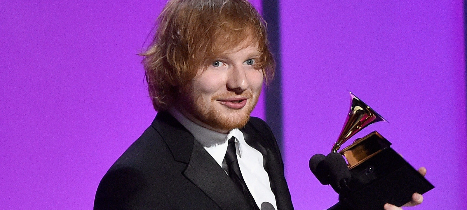 """Singer-songwriter Ed Sheeran accepts the Grammy Award for Best Pop Solo Performance, for """"Thinking Out Loud,"""" onstage during the GRAMMY Pre-Telecast at The 58th GRAMMY Awards at Microsoft Theater on February 15, 2016 in Los Angeles, California."""