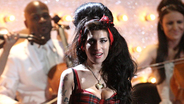 Mark Ronson and Amy Winehouse perform on stage at the BRIT Awards 2008 at Earls Court 1 on February 20, 2008 in London, England.