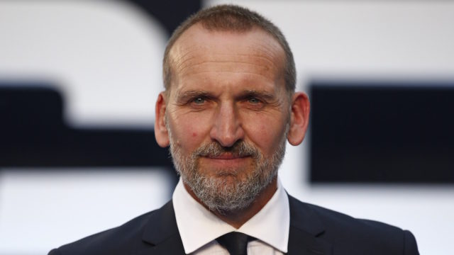 "British actor Christopher Ecclestone poses for pictures on the red carpet after arriving to attend the world premier of ""Legend"" in central London on September 3, 2015."