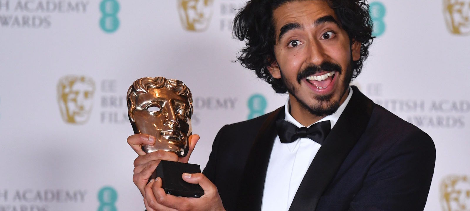 British actor Dev Patel poses with the award for a Supporting Actor for his work on the film 'Lion' at the BAFTA British Academy Film Awards at the Royal Albert Hall in London on February 12, 2017.