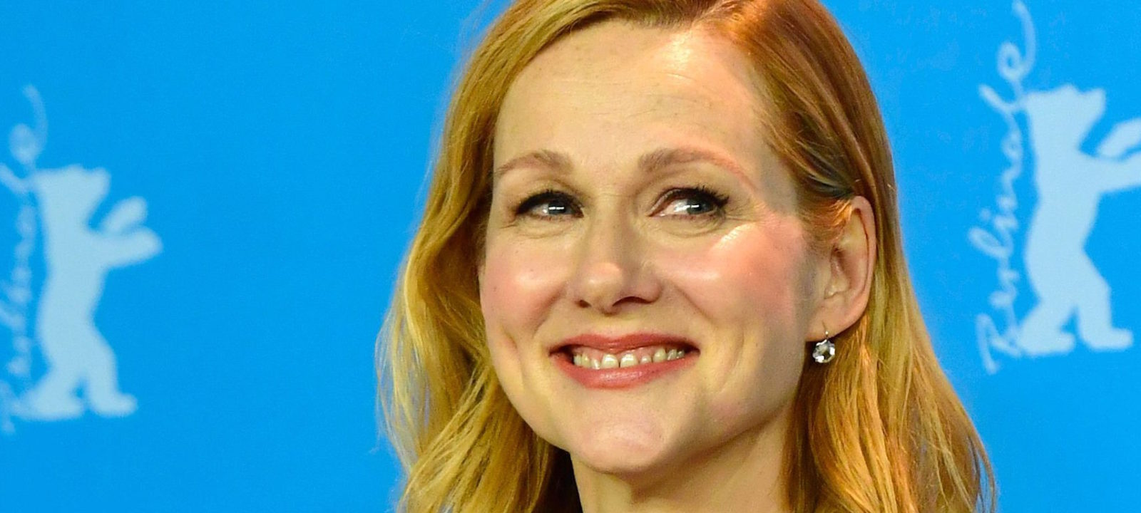 "US actress Laura Linney poses for photographers during a photocall for the film ""The Dinner"" in competition at the 67th Berlinale film festival in Berlin on February 10, 2017. / AFP / John MACDOUGALL"