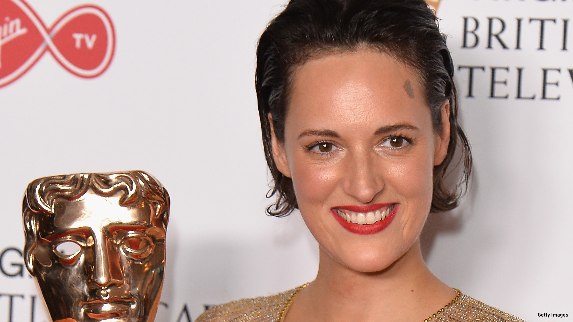 Phoebe Waller-Bridge poses with the award for Female Performance in a Comedy Programme in the Winner's room at the Virgin TV BAFTA Television Awards at The Royal Festival Hall on May 14, 2017 in London, England.