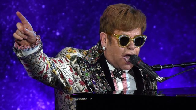 "Pop legend Elton John on Wednesday announced a final tour, saying he intends to stop traveling to spend more time with his family. The 70-year-old British entertainer, revealing his plans at a gala New York event, said he planned to ""go out with a bang"" with a global tour that may last several years.  / AFP PHOTO / TIMOTHY A. CLARY"
