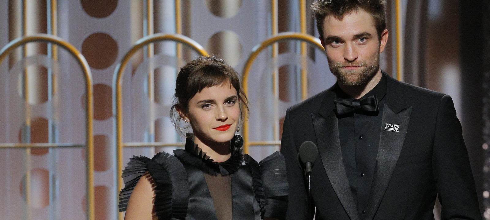 Emma Watson and Robert Pattinson speaks onstage during the 75th Annual Golden Globe Awards at The Beverly Hilton Hotel on January 7, 2018 in Beverly Hills, California.