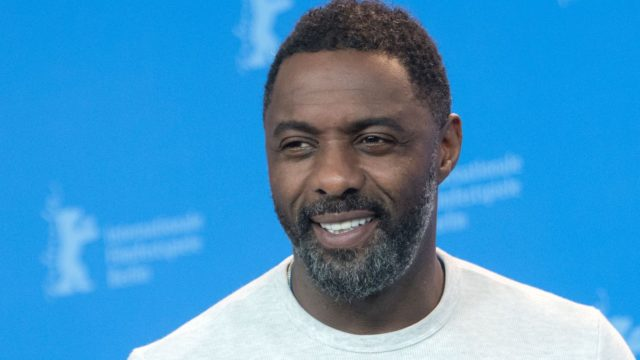 """British actor, director and executive producer Idris Elba poses during a photo call for the film """"Yardie"""" shown in the """"Panorama Special"""" category during the 68th edition of the Berlinale film festival in Berlin on February 22, 2018. / AFP PHOTO / Stefanie LOOS"""