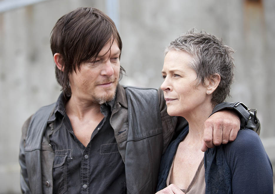 Daryl Dixon (Norman Reedus) and Carol Peletier (Melissa McBride) in Episode 1 of The Walking Dead