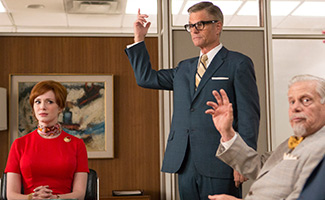 Joan Harris (Christina Hendricks), Jim Cutler (Harry Hamlin), and Bert Cooper (Robert Morse) on Mad Men