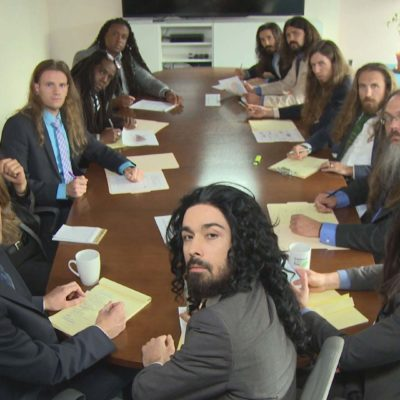 IFC_FOD_TV_long_haired_businessmen_table