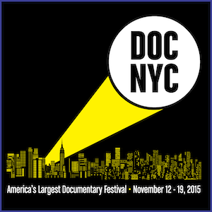 2015 DOC NYC Shirt - Yellow skyline and yellow-white spotlight, with words DOC NYC in the spotlight circle, and text America's Largest Documentary Festival - November 12-19, 2015. Black Shirt.